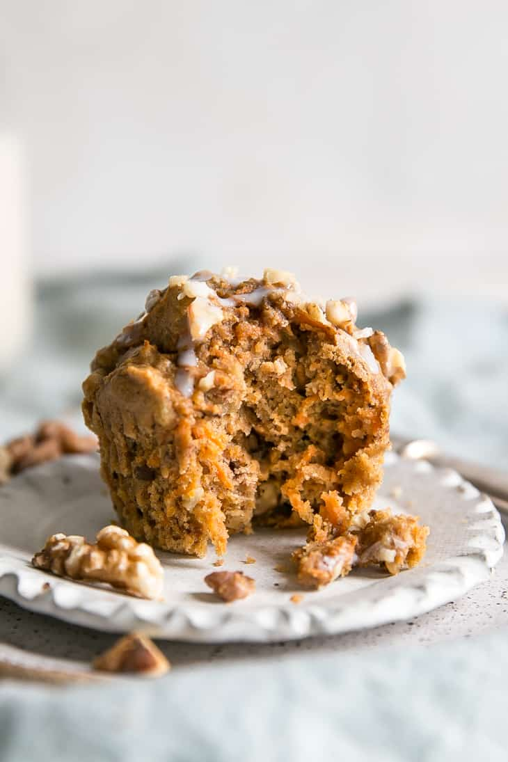 Carrot Muffins with walnuts on white plate