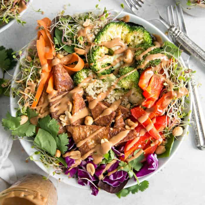 overhead detail of peanut buddha bowl with colorful vegetetables