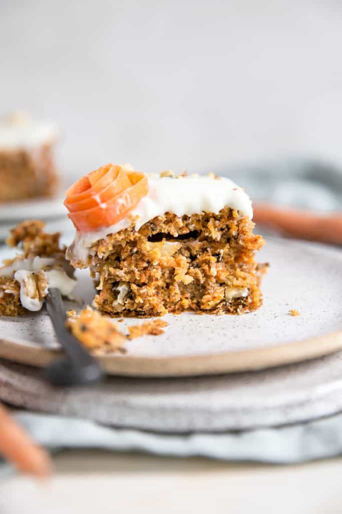 bite out of pineapple carrot cake on plate