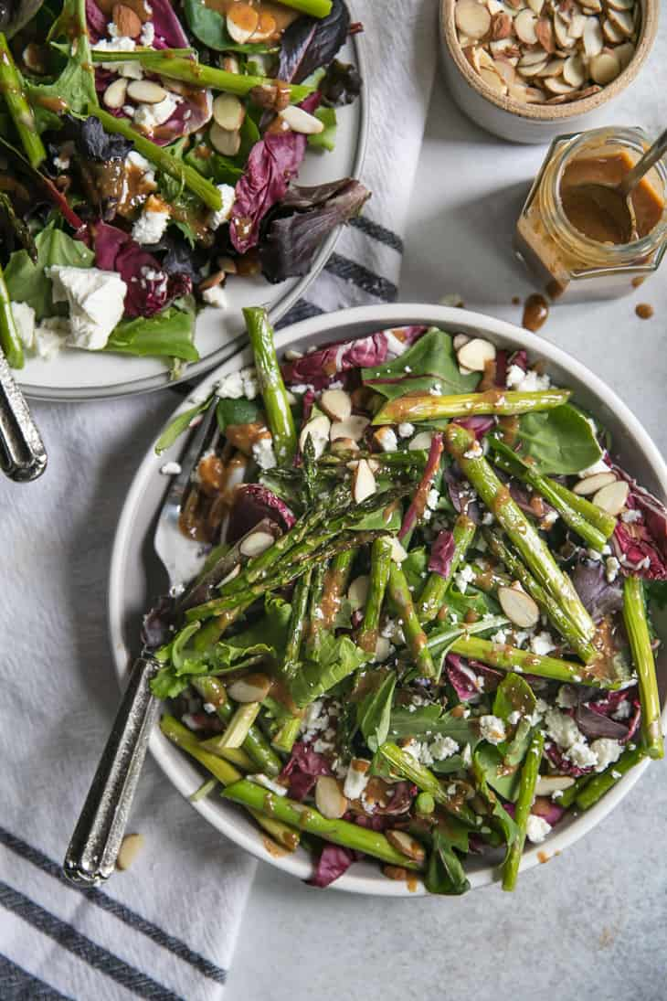 salad with asparagus on plate with feta and dressing