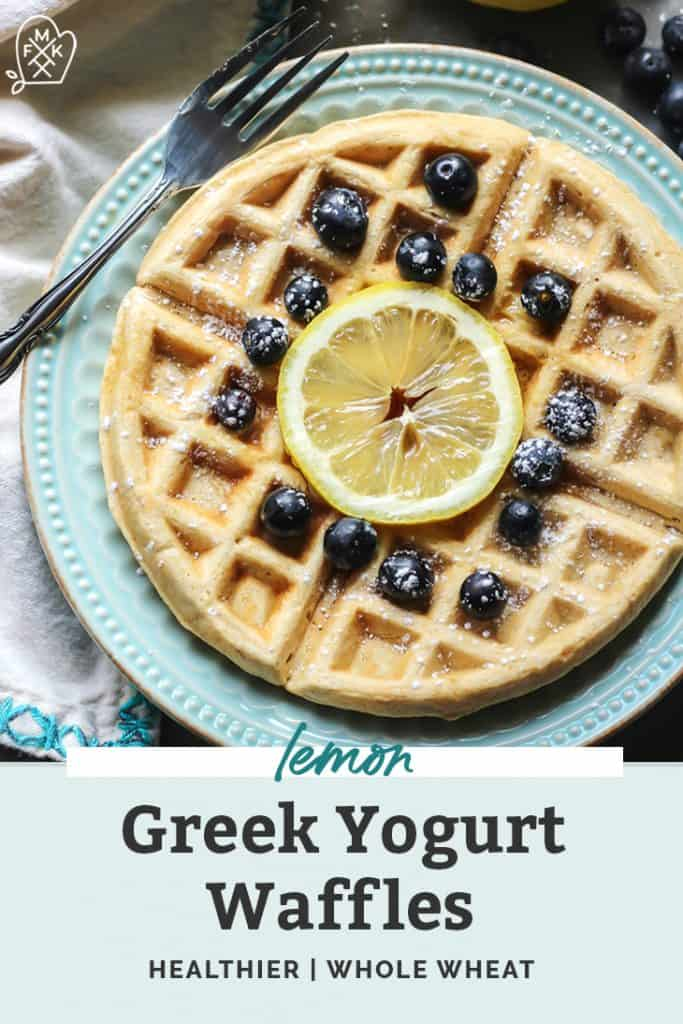 waffles with lemon slice and blueberries on blue plate with fork pinterest