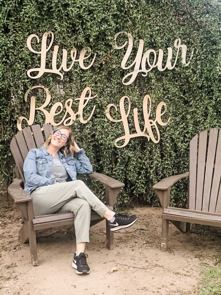 Live your Best Life sign with chairs