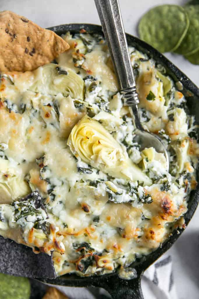close up of baked spinach artichoke dip