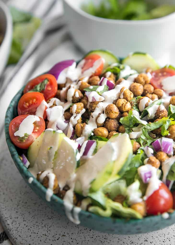 chickpea salad in bowl with sauce