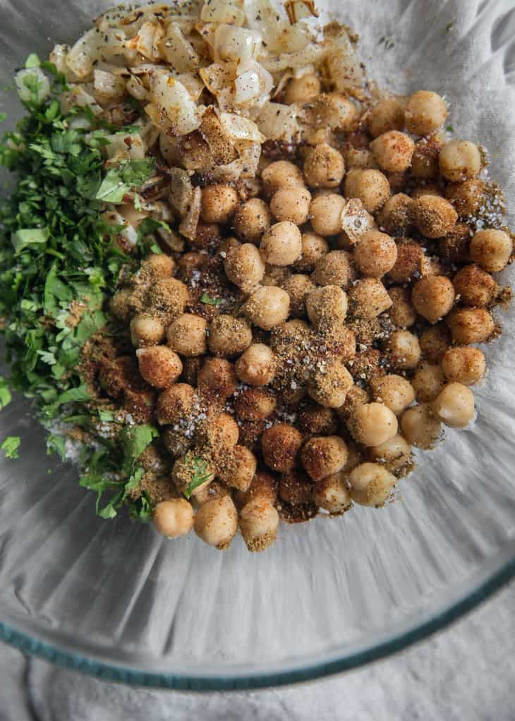 bowl of chickpeas with spices and herbs