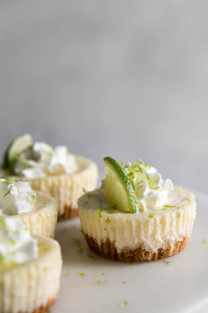 lime wedge on top of mini cheesekcake
