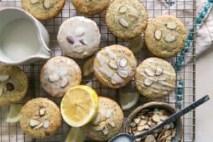 baked paleo lemon poppy seed muffins cooling on rack