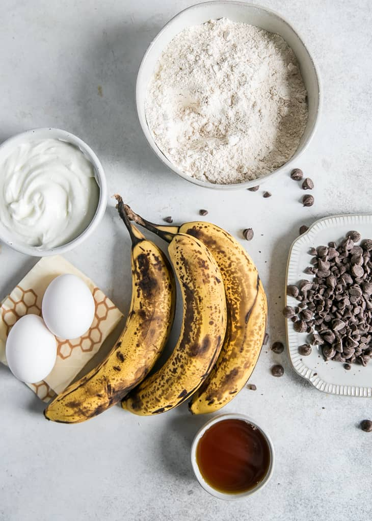 spotty brown bananas, flour and yogurt in bowls
