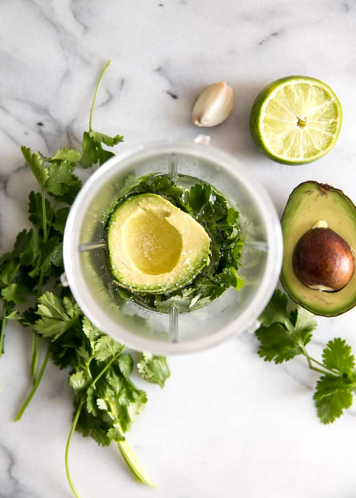 avocado in blender cup with cilantro