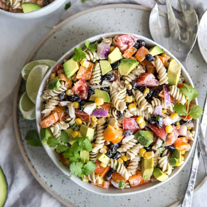 southwest pasta salad with serving spoons