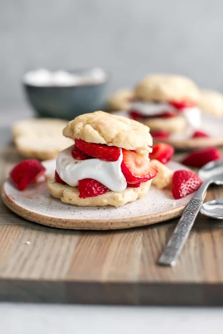 strawberry shortcake biscuit on wood board with spoon