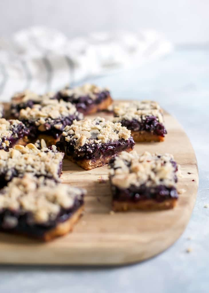 cut blueberry crumb bars on cutting board