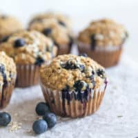 blueberry oatmeal muffins on parchment paper