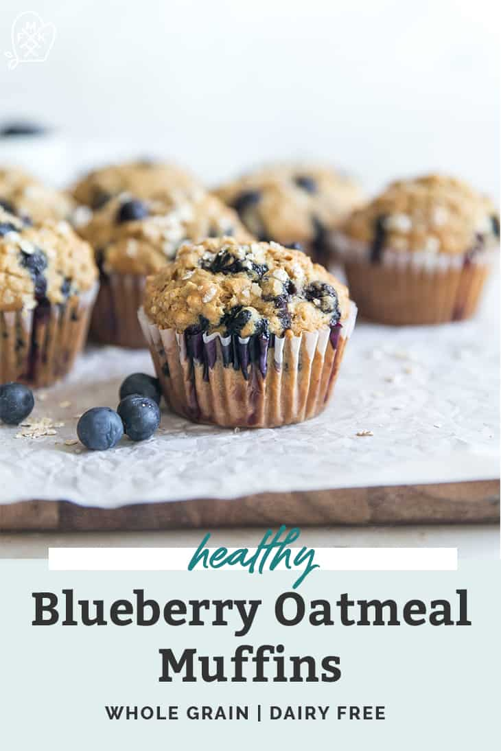 blueberry muffins with oat crumble on wood cutting board pinterest