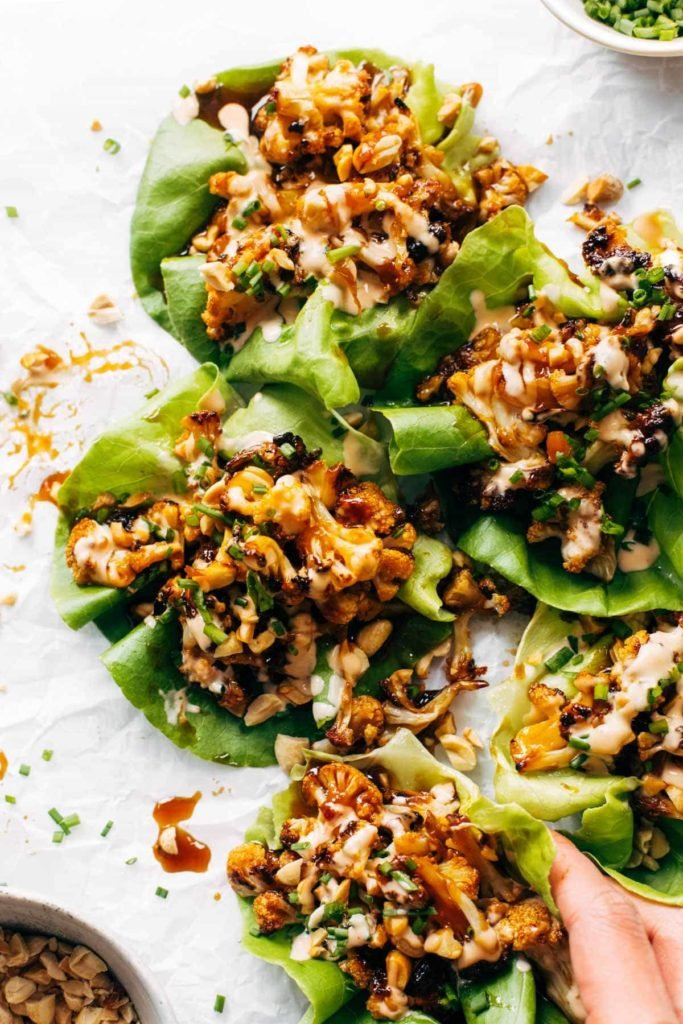 bbq cauliflower in lettuce ups topped sauce