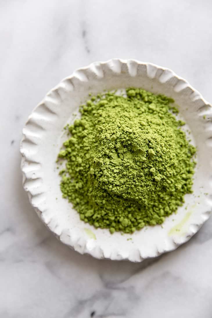 matcha green tea powder in a small cream dish