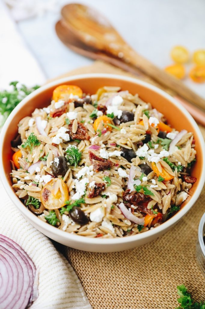 orzo with tomatoes, black olives, feta, and parsley on top