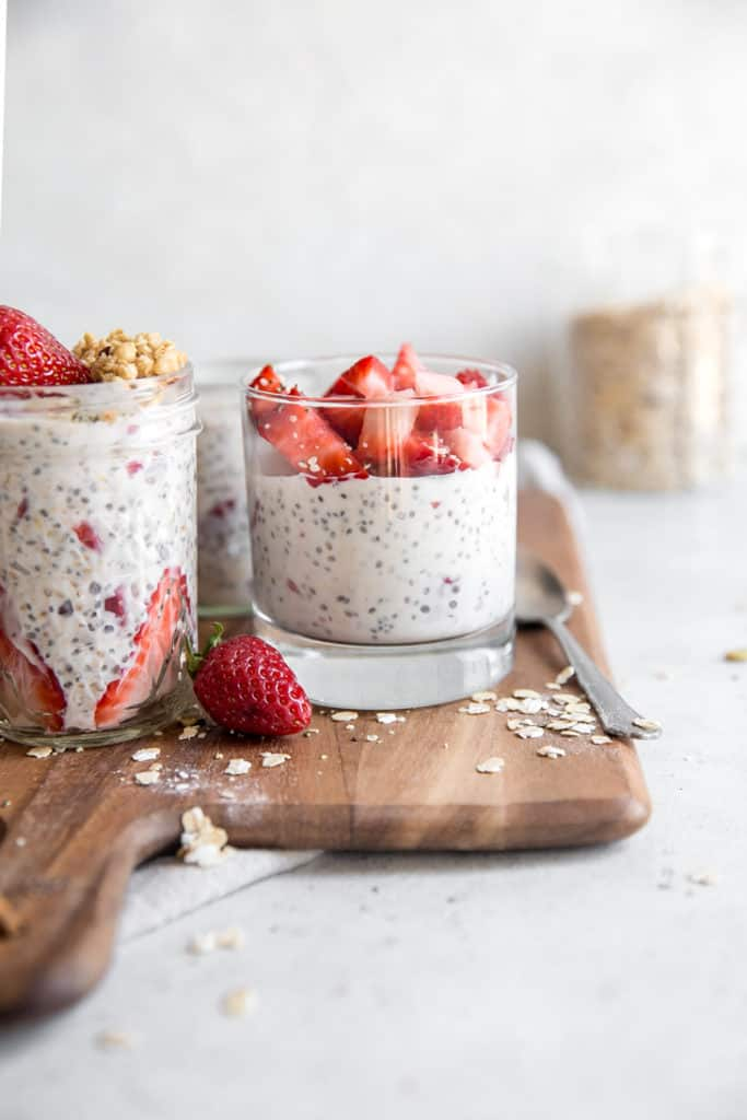 glass jar filled with overnight oats and diced strawberries