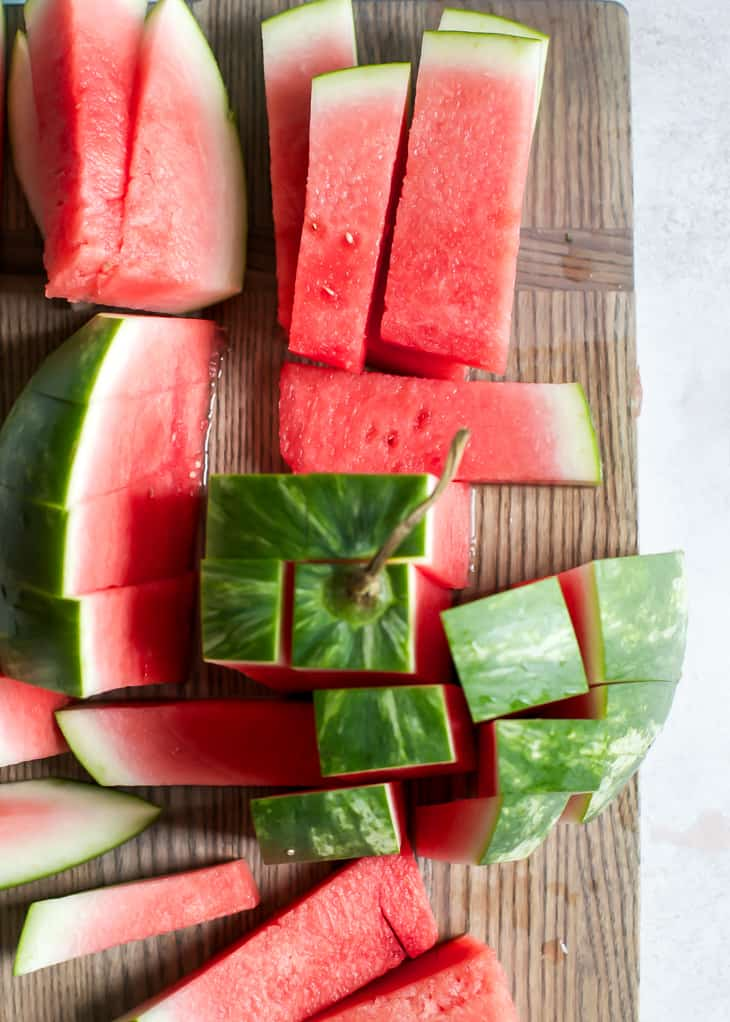 Cut up watermelon half on cutting board