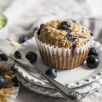blueberry zucchini muffins on stacked plates