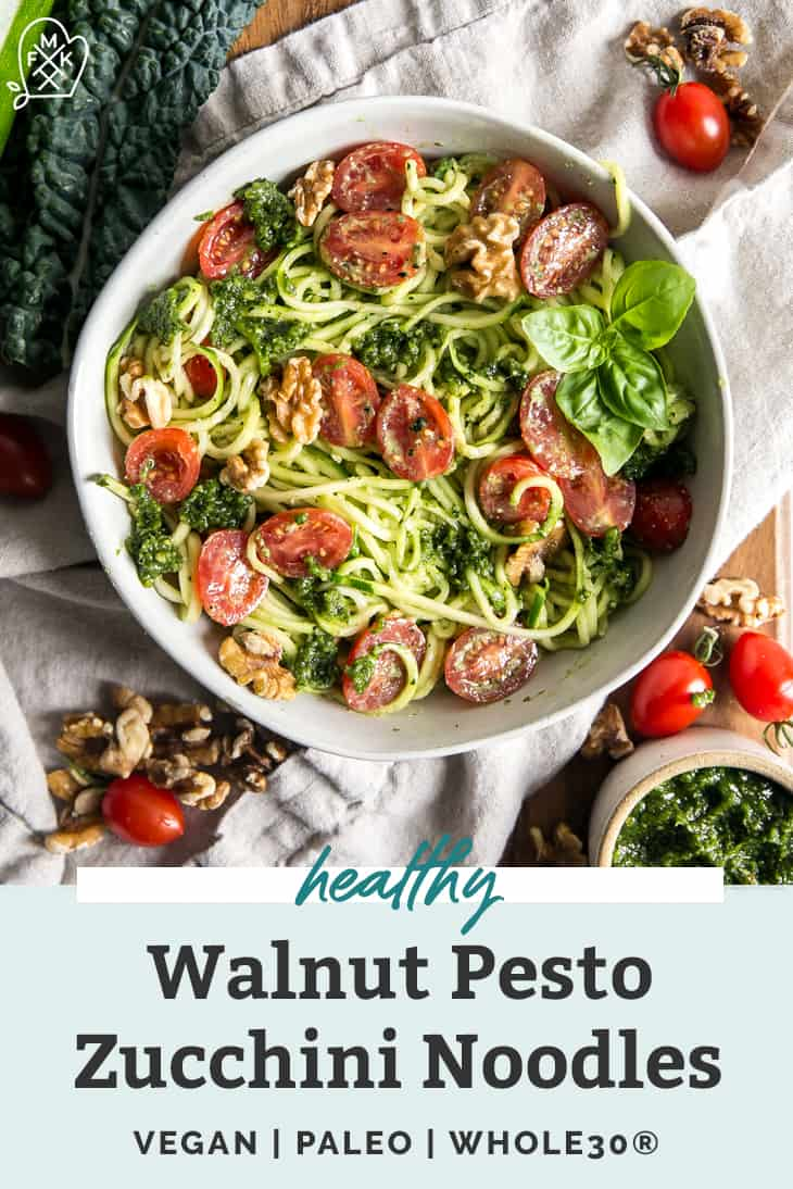 zucchini noodles topped with pesto, tomatoes, and basil in a white bowl painters graphic