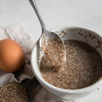 spoon in bowl of flaxseed egg