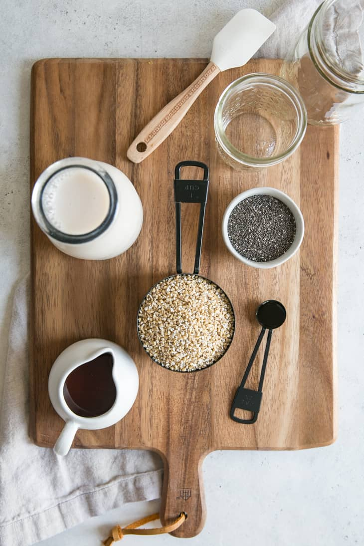 ingredients in measuring cups and bowls on wooden board