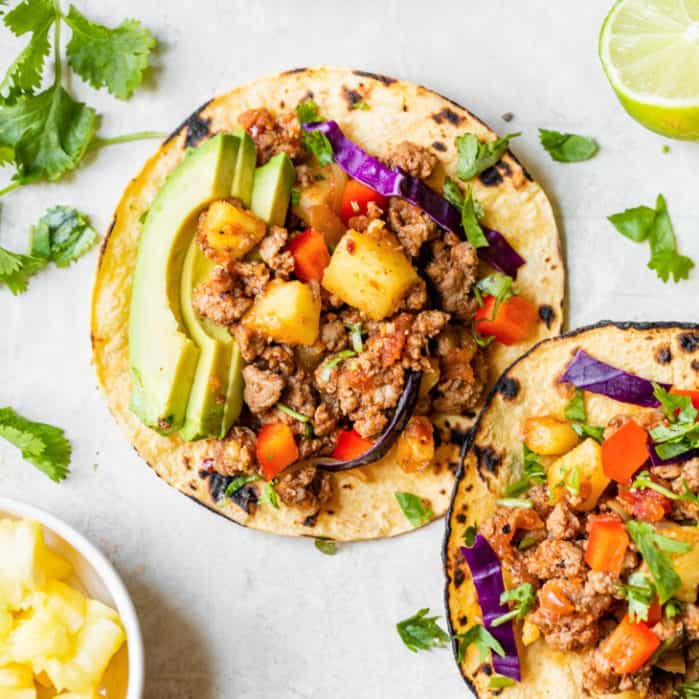 pineapple turkey tacos with avocado and cabbage