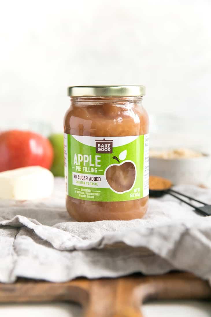jar of apple pie filling on a cutting board