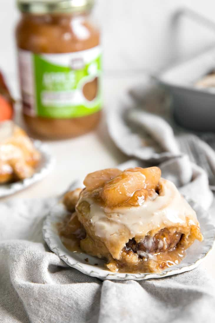 apple pie topped cinnamon roll on plate