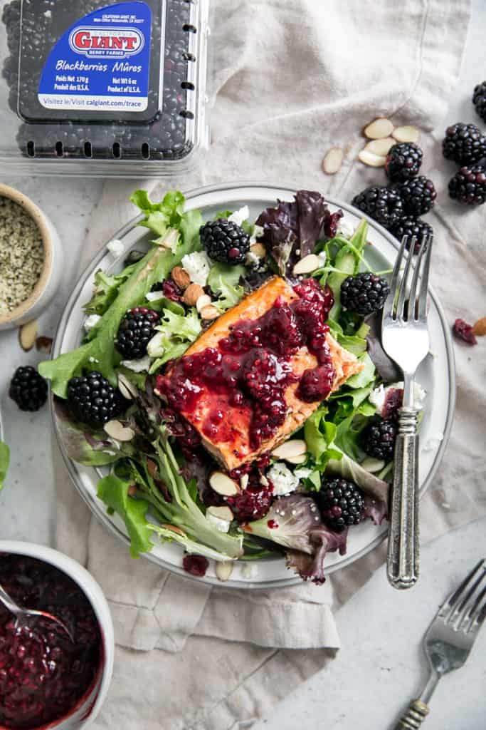 salad topped with blackberries any salmon