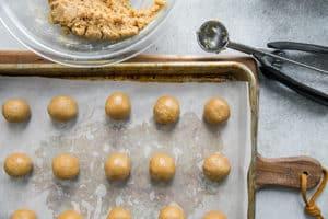 peanut butter buckeye dough balls on parchment paper