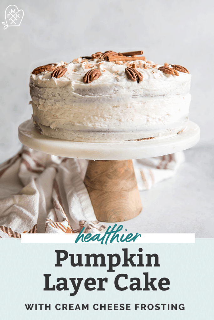 pinterest graphic with pumpkin cake on a white and wooden cake stand topped with pecans