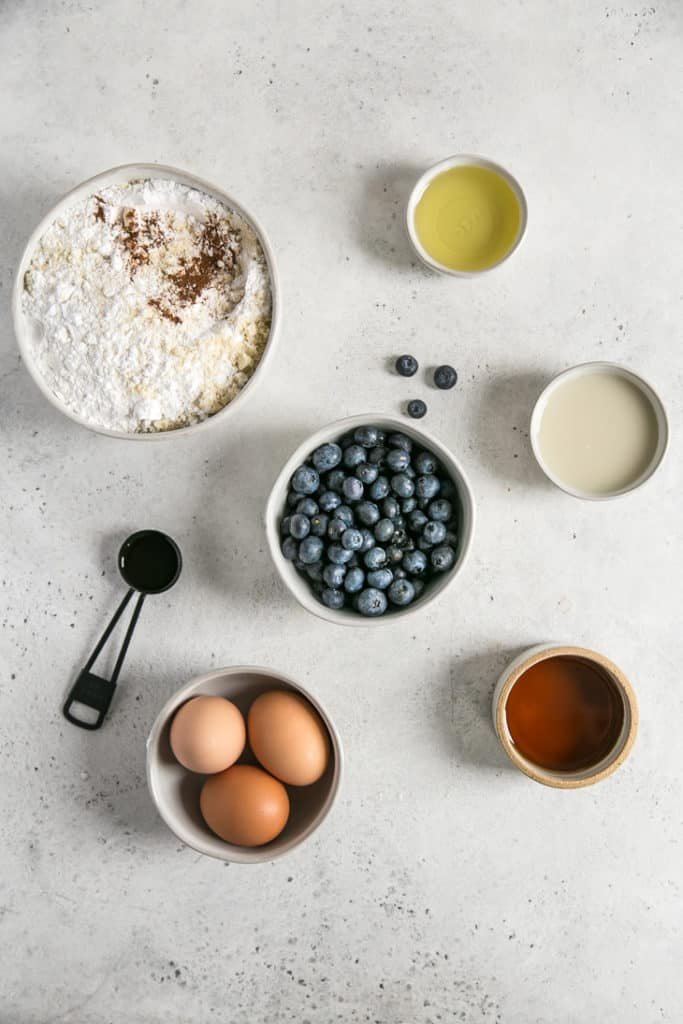 ingredients in bowls for blueberry muffin bread