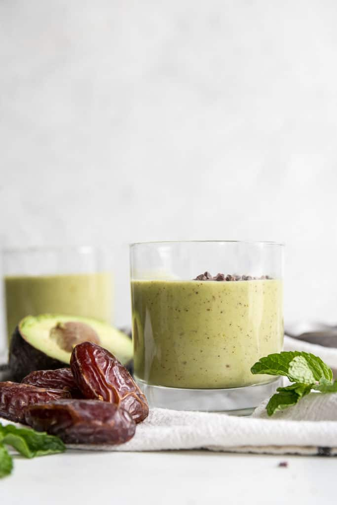 green smoothie topped with chocolate chips