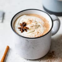chai latte in mug with cinnamon and star anise