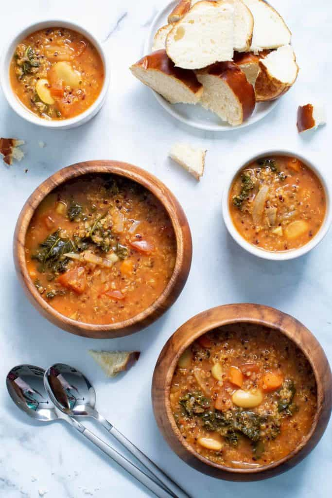 soup on a wooden bowls with bread