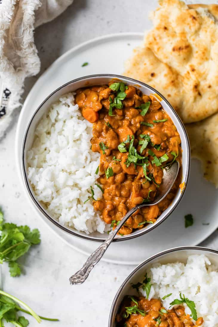 Indian Lentil Curry in bowl with spoon