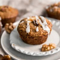 carrot muffins on mini plate with walnuts