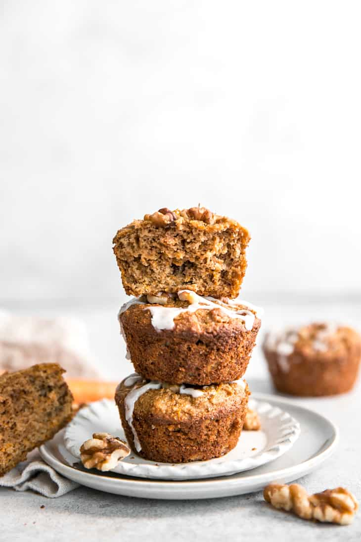 stacked paleo carrot muffins with glaze