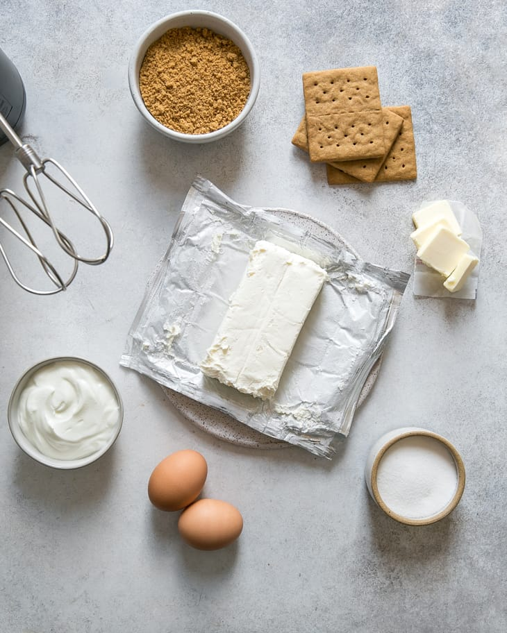 eggs, yogurt, cream cheese, sugar, butter and graham crackers on board