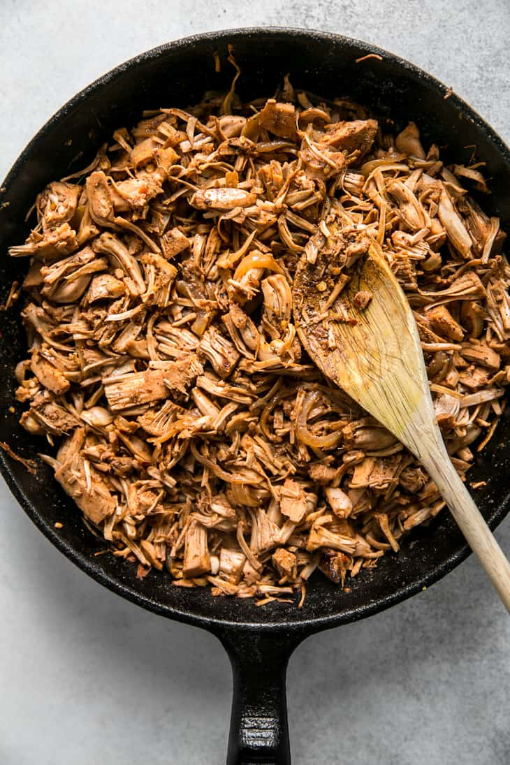 cooked jackfruit taco meat in cast iron skillet