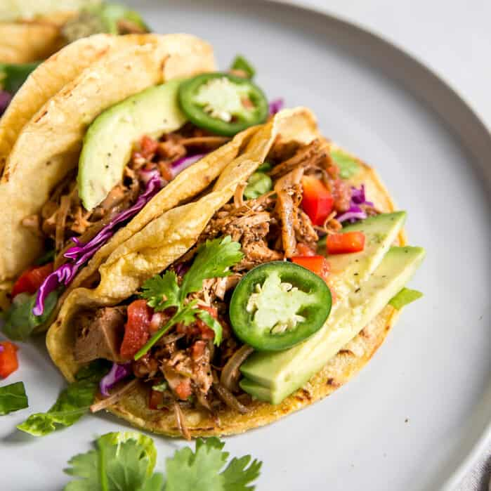 up close image of jackfruit tacos with jalapeno