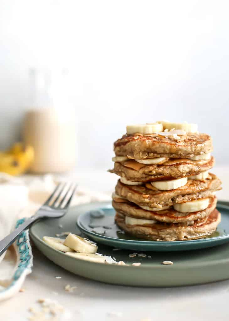 stack of banana pancakes on blue and green plate