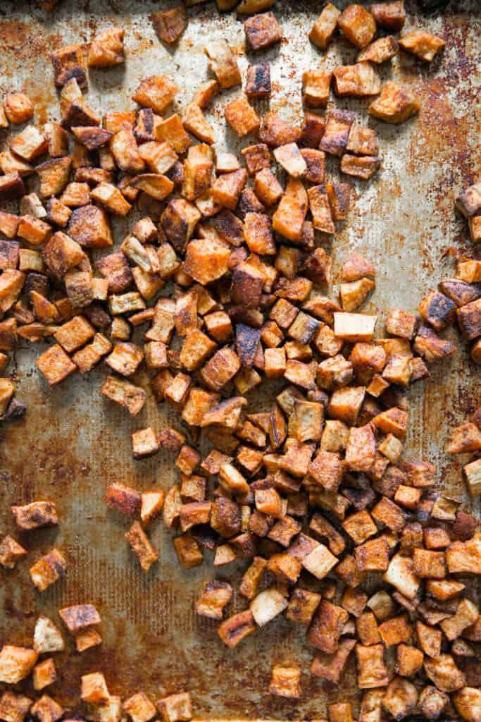 cooked sweet potatoes on baking sheet