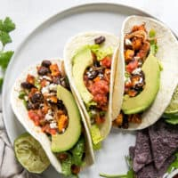three sweet potato tacos on plate
