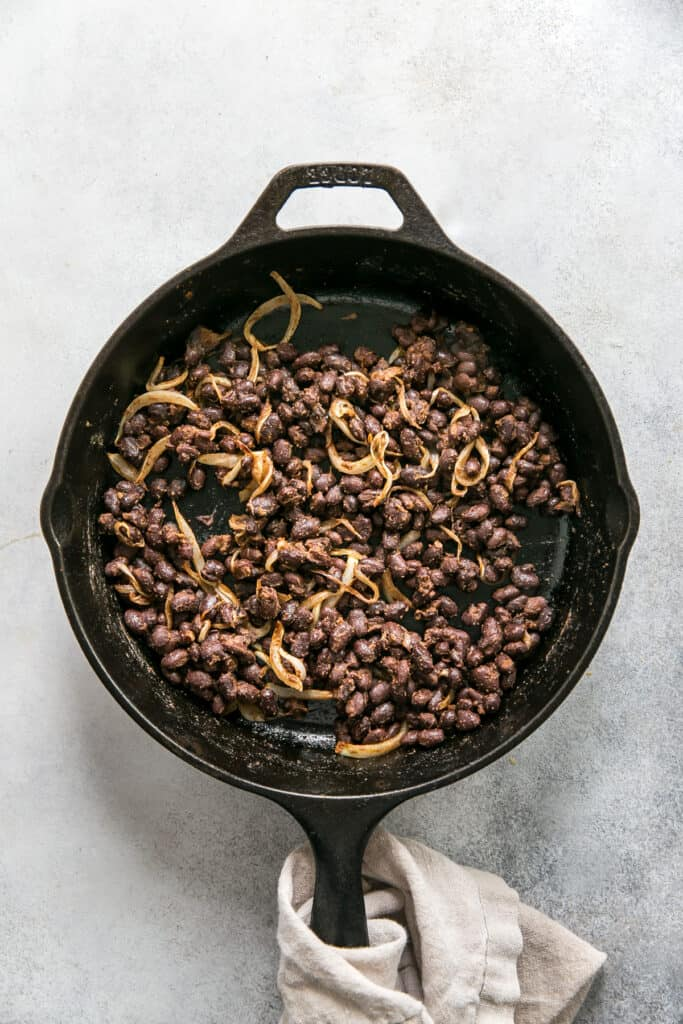 skillet of onions and black beans
