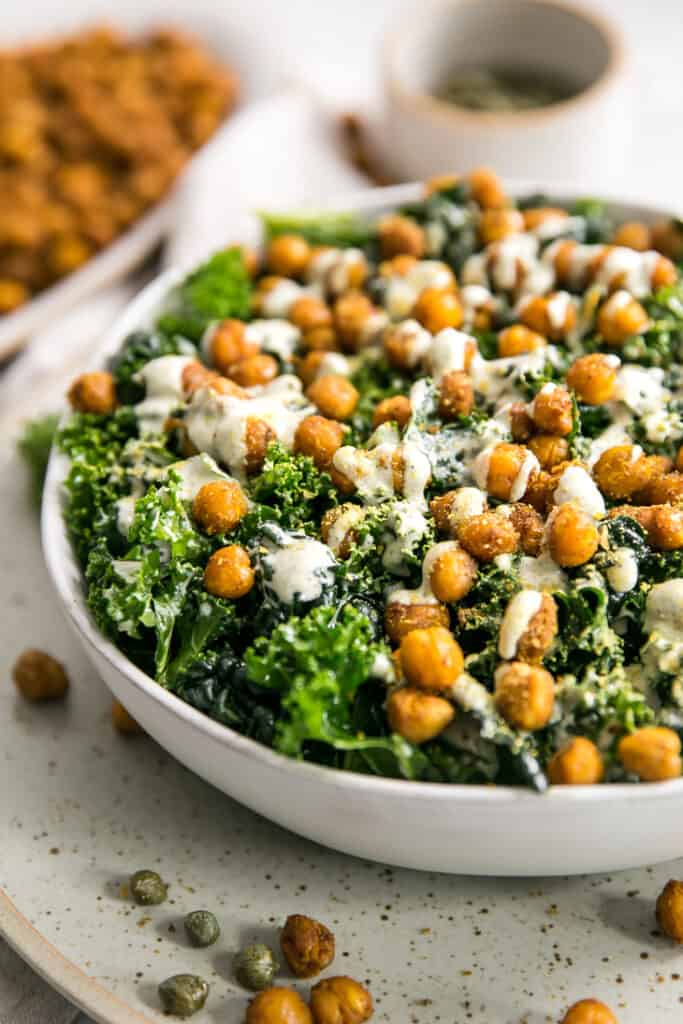 salad topped with chickpeas in a white bowl