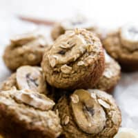 banana oat muffins with banana slices on top