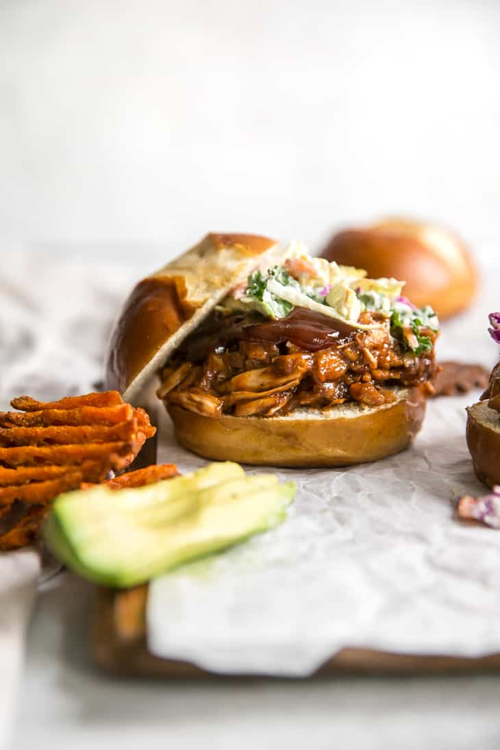jackfruit sandwich topped with bbq and coleslaw